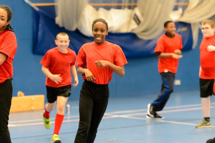 School children running indoors