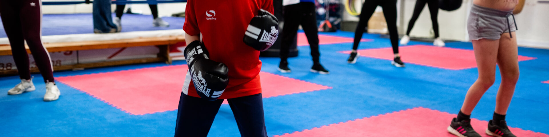 young girl in boxing class