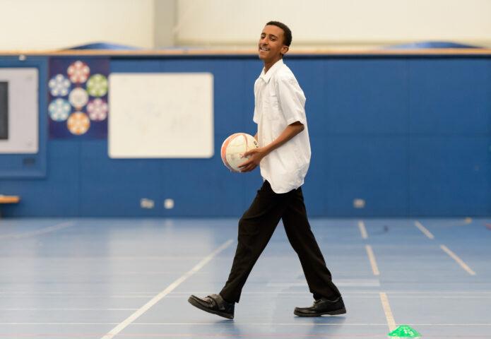 Boy playing netball