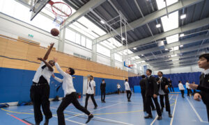 Children playing basketball in a sports hall