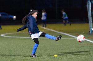 Girl playing football