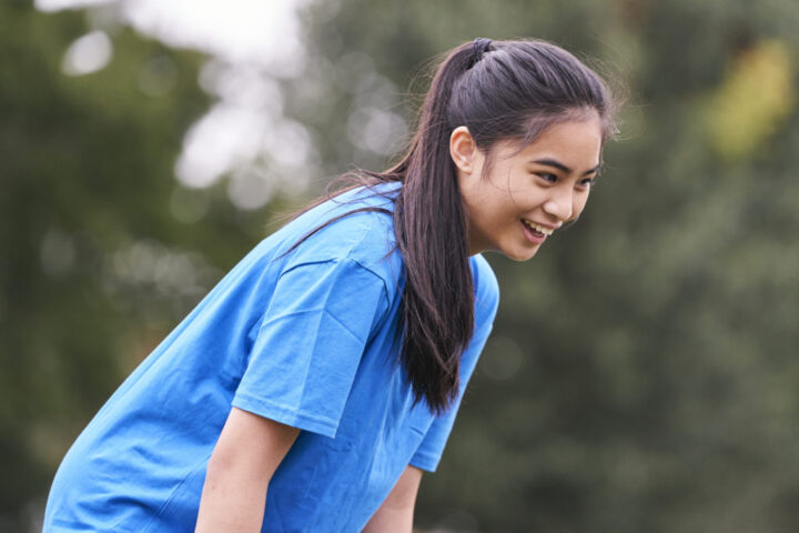 Girl playing rugby
