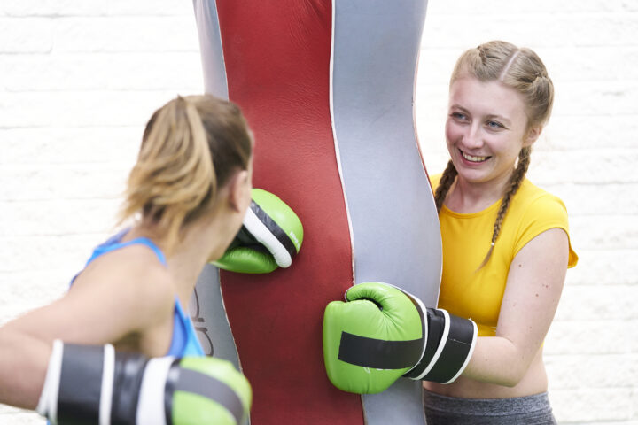 women boxing with a punchbag