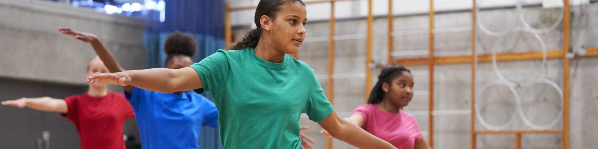 Girls dancing in a school gym