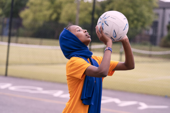 Young person playing netball