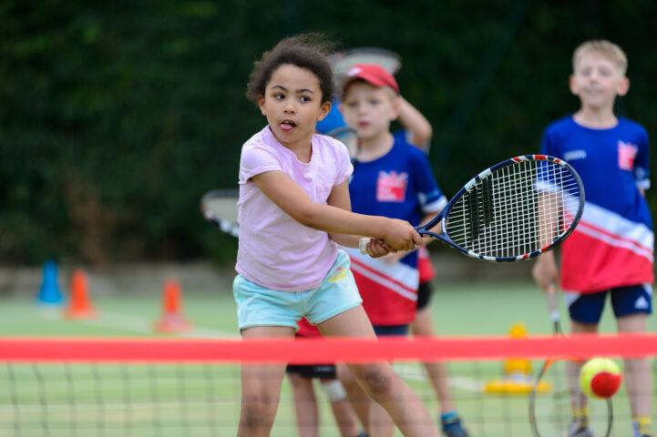 Children playing tennis