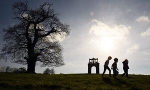 Visitor walking near Hadrian's Arch on the Shugborough Estate